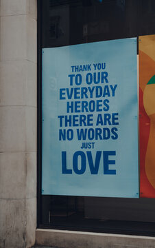 Thank You sign in the window of a shop in London, UK.