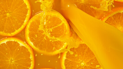 Freeze motion of pouring orange juice. Top view, close-up.
