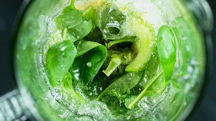 Green fresh smoothie blended in blender, top view. Healthy eating concept.