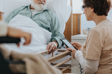 Helpful nurse switching on a professional bed in a nursing home