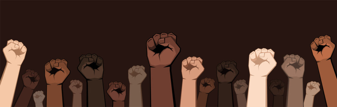 Many raised fists of different shades.