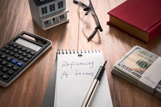 refinancing words on notebook