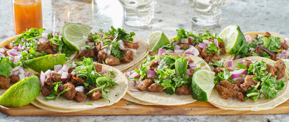 Wall Mural - wooden tray with carne asada tacos on corn tortilla