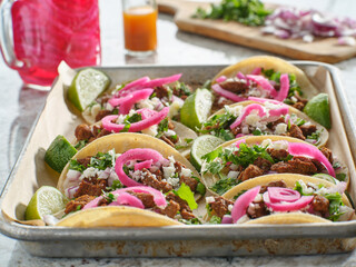 Wall Mural - tray of carne asada tacos topped with pickled onions and cojita cheese