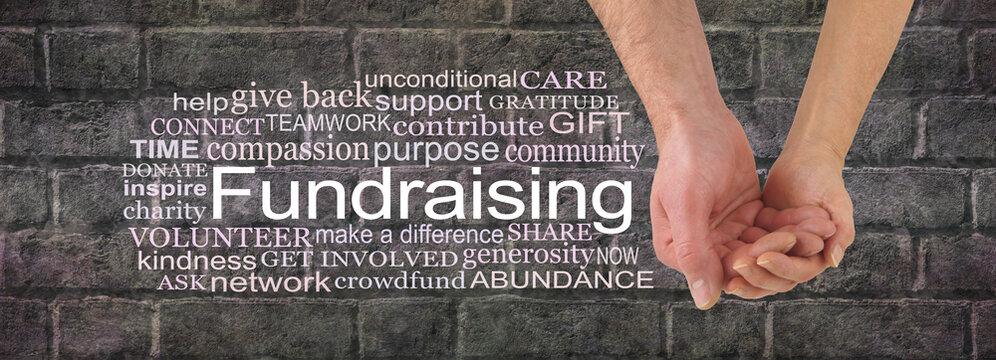 Get together and get involved in a fund raising campaign - male and female cupped hands beside the word FUNDRAISING surrounded by a relevant word cloud against a dark grey brick wall background