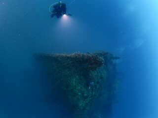 Fotobehang Schipbreuk scuba divers exploring a ship wreck submarine u boat underwater worl war 2 ocean floor
