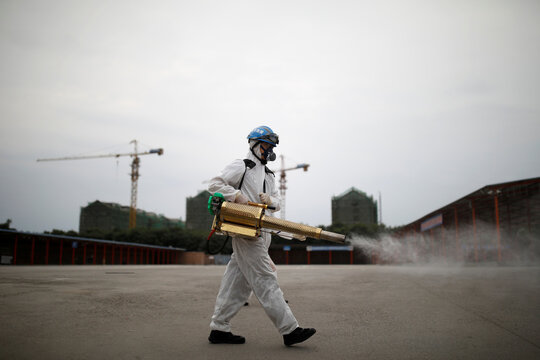 Volunteer from the Blue Sky Rescue team disinfects the Nangong comprehensive market in Beijing