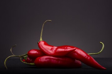 Canvas Prints Hot chili peppers Closeup shot of the fresh red hot chili peppers isolated on the black background