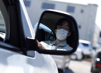 Ryota Kawamata, 32-year old engineer of Sanko Manufacturing Co. is seen at the driver's seat of a car, in Saitama