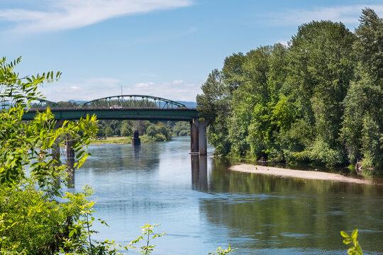 Willamette river in Albany, Oregon, and the bridge over it in summer season