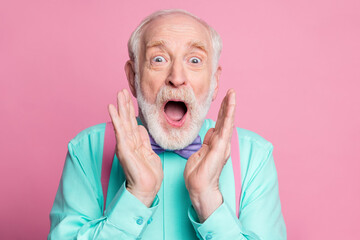 Closeup photo of excited crazy attractive grandpa open mouth listen good news astonished facial expression wear mint shirt suspenders bow tie isolated pink pastel background