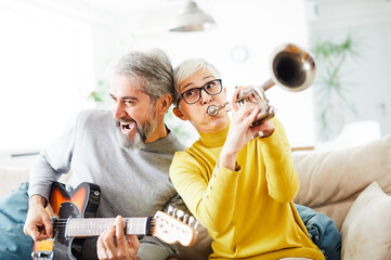 senior couple man woman love retired healthy party playing instrument guitar trumpet fun band iplay