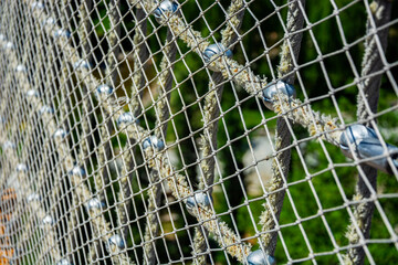 Net on thick rope, on green background