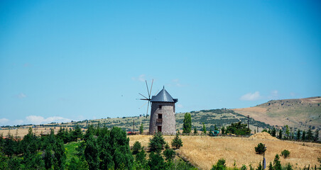 blue sky, wheat fields and historic windmill