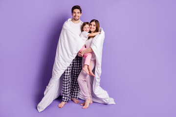 Full length body size view of cheerful family mom dad small little daughter covered duvet stay home...