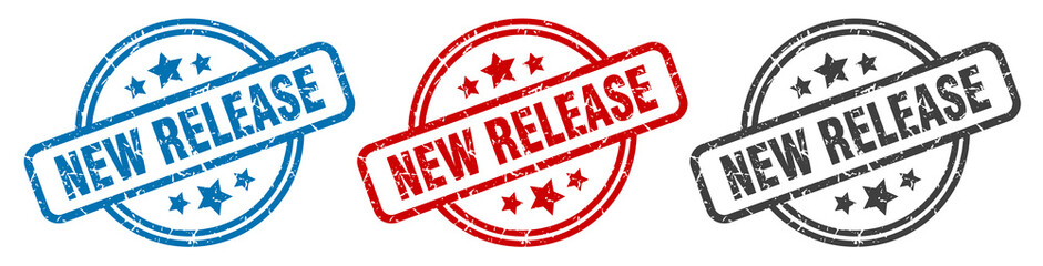 new release stamp. new release round isolated sign. new release label set