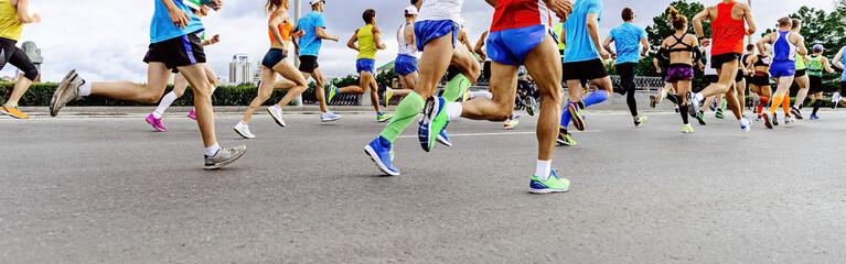 Wall Mural - group runners men and women run marathon race in city