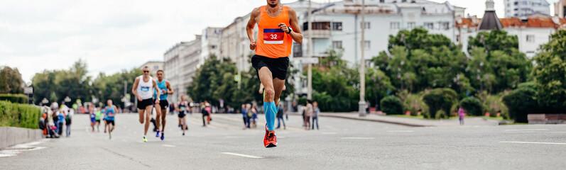 Wall Mural - athlete runner leader to run marathon race ahead group of runners