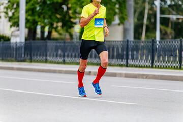 Fotomurales - man runner athlete in compression socks running city marathon race