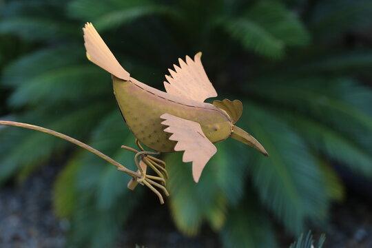 Rusted steel bird garden ornament
