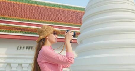 Wall Mural - Backpack traveller women take photo in pagoda of temple Bangkok Thailand