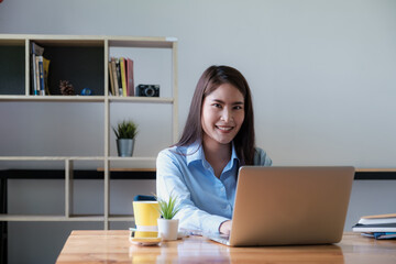Portrait of Asian Business woman working from home. Accounting concept.