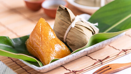 Zongzi - Alkaline rice dumpling - Traditional sweet Chinese crystal food on a plate to eat for...
