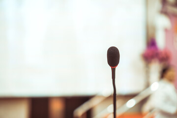 Microphone for speaker of speech on stage for speaking audience at seminar conference room, Mini mic event for lecture to audience university, Convention hall in Business Talk speaking in training