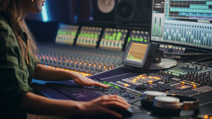 Beautiful, Stylish Female Audio Engineer, Producer Working in Music Recording Studio, Uses Mixing...