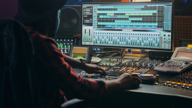 Music Creator, Musician, Artist Works in the Music Record Studio, Uses Surface Control Desk Equalizer Mixer. Buttons, Faders, Sliders to Broadcast, Record, Play Hit Song. Close-up Shot