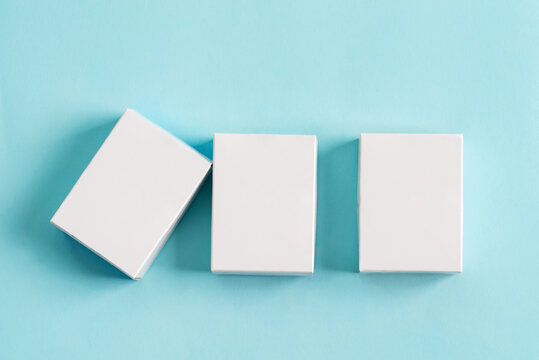 Set from three paper mock up boxes for packaging products and things on a pastel blue background.