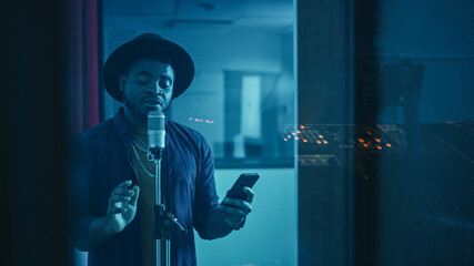 Portrait of Successful Young Black Artist, Singer, Performer Singing His Hit Song for the New...