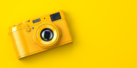 Yellow vintage photo camera on yellow background.
