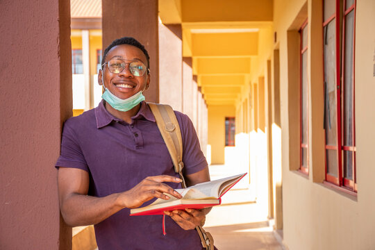 portrait of an african student wearing face mask smiling