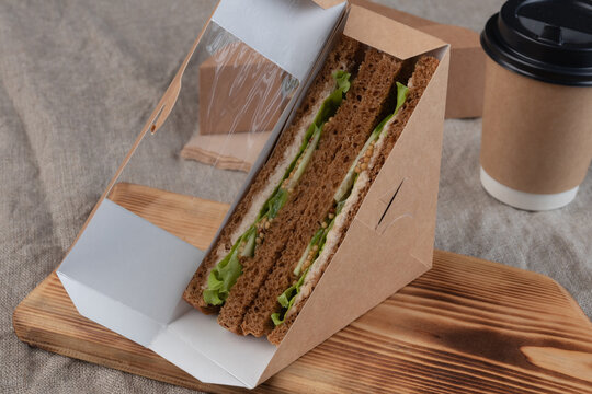 Eco-friendly coffee and sandwiches with fresh vegetables, tuna, salmon and herring paste. Vegan food.