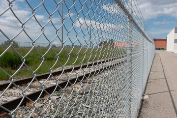 Chain Link Mesh Fence in front of Railway Track