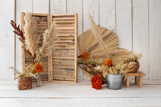 Old wooden background with red flowers.