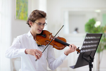 Man playing violin. Classical music instrument.
