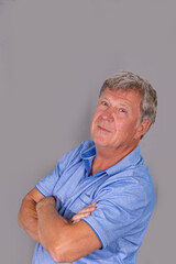portrait of sixty year old attractive senior man in blue shirt