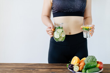 Detox and hydration. Fit woman drinking infused water. healthy lifestyle, dieting and clean eating....
