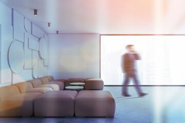 Man walking in white geometric pattern living room
