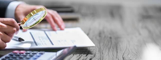 Tax Audit Using Magnifying Glass - fototapety na wymiar