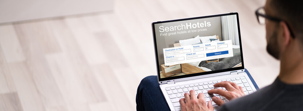 Man Booking Hotel On Website