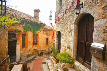 Inside the old streets of the beautiful hilltop medieval village of Eze. Historic buildings with steep steps & atmosphere, French Riviera, south of France