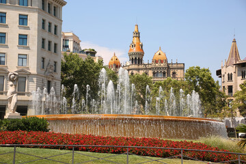 Beautiful fountain & gardens at the center of the city in the downtown area, Placa de Catalunya or Catalonia Square, Barcelona, Spain.