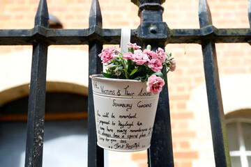 A view shows a floral tribute to the victims at the scene of multiple stabbings in Reading