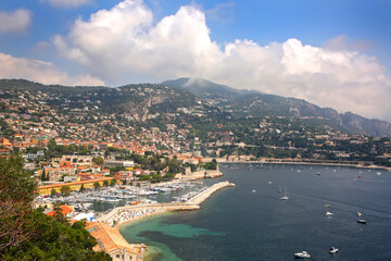 Beautiful view of the French riverira town of Villefranche sur Mer, on the coastline of the mediteranean sea, with a marina, tourist resort, France.