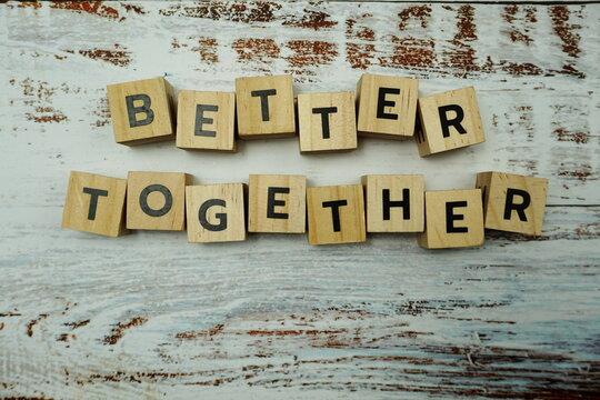 Better Together alhpabet letter on wooden bakground