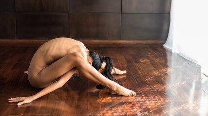 Naked woman yoga in house