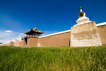 Walls of the historic city of Kharkhorin behind tall grass, Mongolia